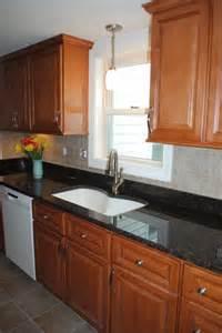 vinyl kitchen backsplash maple cabinets brown granite tile backsplash vinyl floors traditional kitchen other