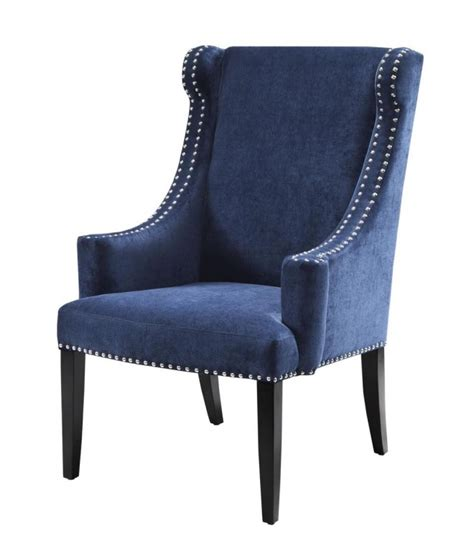 blue wing chair with silver nailhead accent