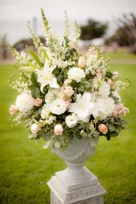 amazing peach  white ceremony floral arrangement