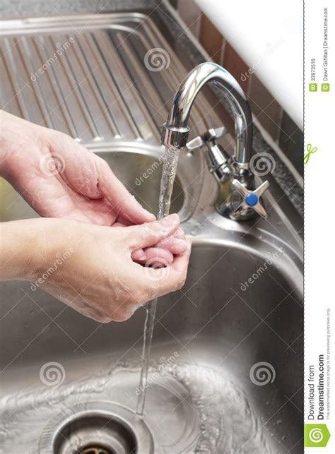 washing hands  sink stock photo image  home care