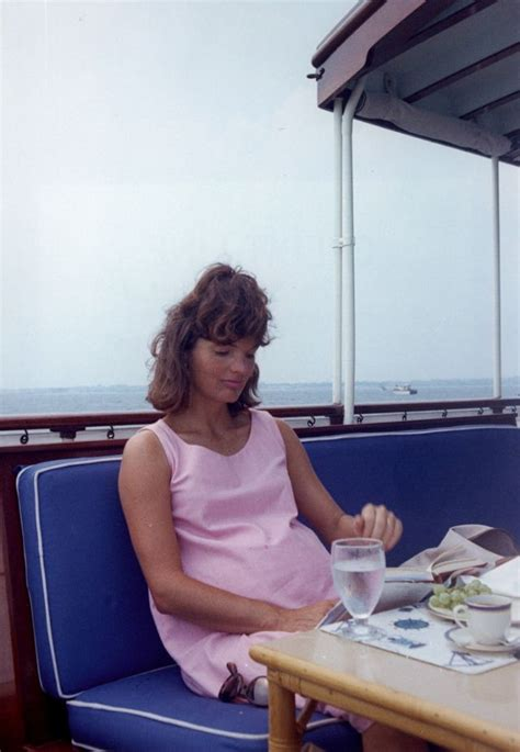 pregnant jackie kennedy enjoying  cigarette