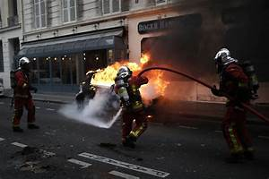 French riot police fire tear gas to stop yellow-vested ...