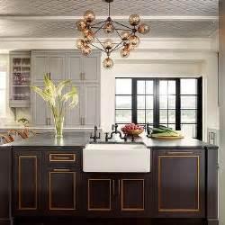gold  black kitchen  thick white marble countertops