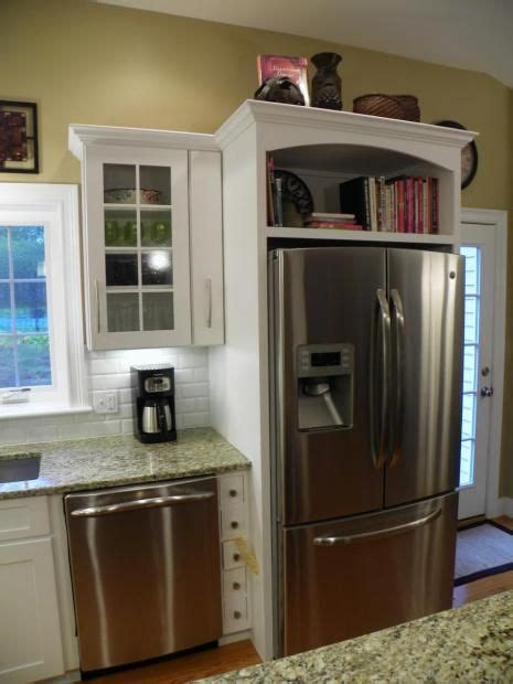 cabinet designs for kitchens 17 best ideas about refrigerator cabinet on 5053