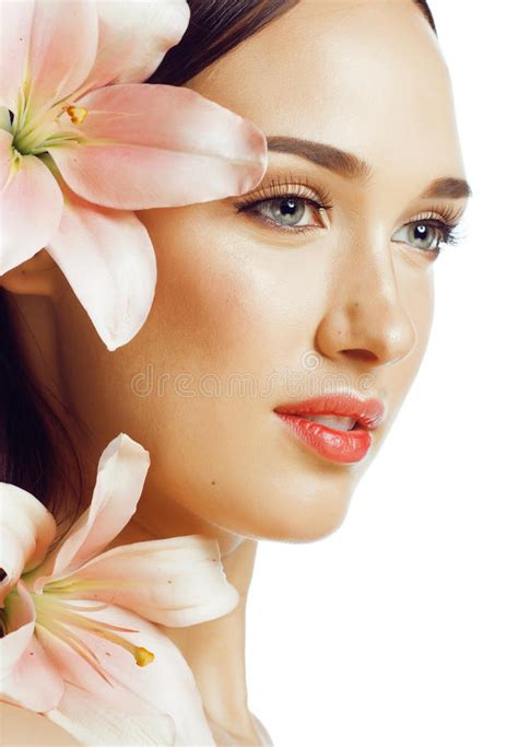 Young Attractive Lady Close Up With Hands On Face Isolated