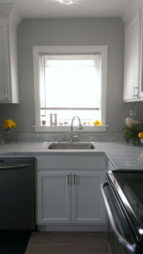 gray wall, white cabinets, deep undermount sink, carrara