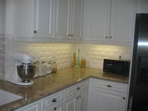 subway tile creme granite counters white cabinets stainless steel appliances   home