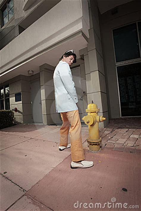 man urinating   fire hydrant royalty  stock photo