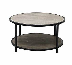 10 coffee tables perfect for a small living room for Round weathered coffee table