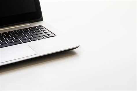 closed laptop   white desk  glasses stockfreedom