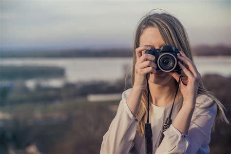 Take Photo - photographer is holding dslr taking
