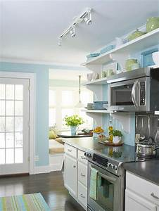 A small cottage kitchen makeover in new york hooked on for Kitchen colors with white cabinets with nyc skyline wall art