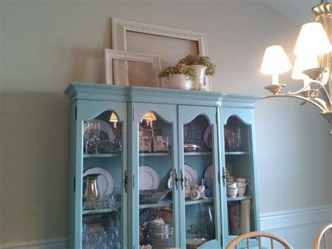how to decorate a china cabinet rearranging the top of the china cabinet cclem