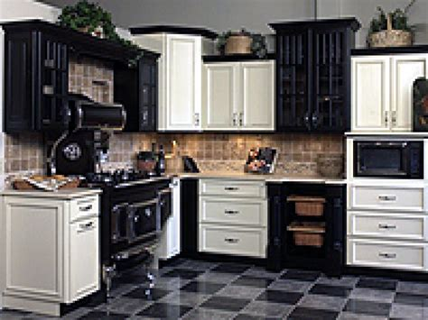 kitchen with black and white cabinets venturing to the side of cabinets hgtv 9627