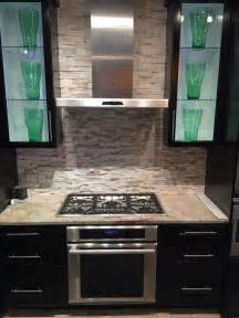 installing subway tile backsplash in kitchen can you place a gas electric induction cooktop a wall