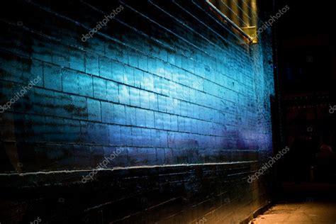 blue light reflect on brick wall stock 169