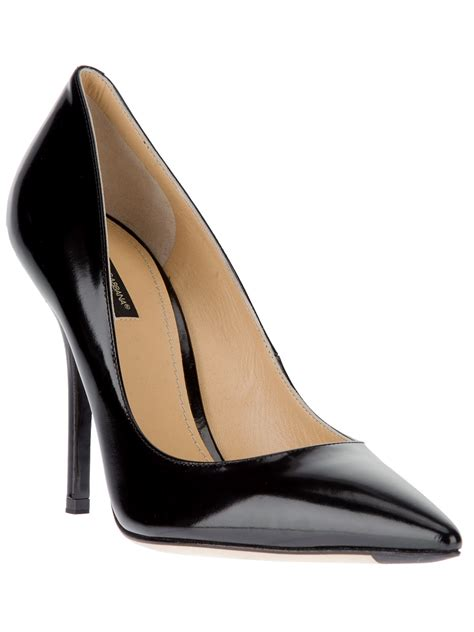 three black leather pumps from dolce gabbana or is it