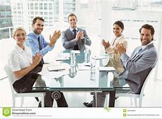 Business People Clapping Hands In Board Room Meeting Stock