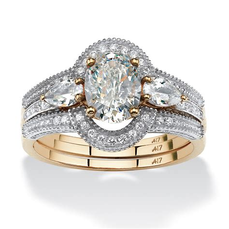 1 75 tcw oval cut cubic zirconia 3 piece halo bridal in 10k gold at palmbeach jewelry