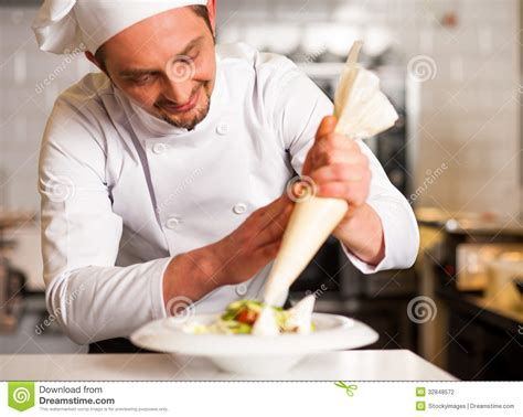 Professional Chef Decorating The Dish Stock Photography