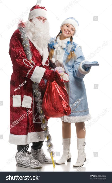 Santa Claus With Maiden In Bright Clothes Stock Santa Claus Maiden Stretched Palm Stock Photo