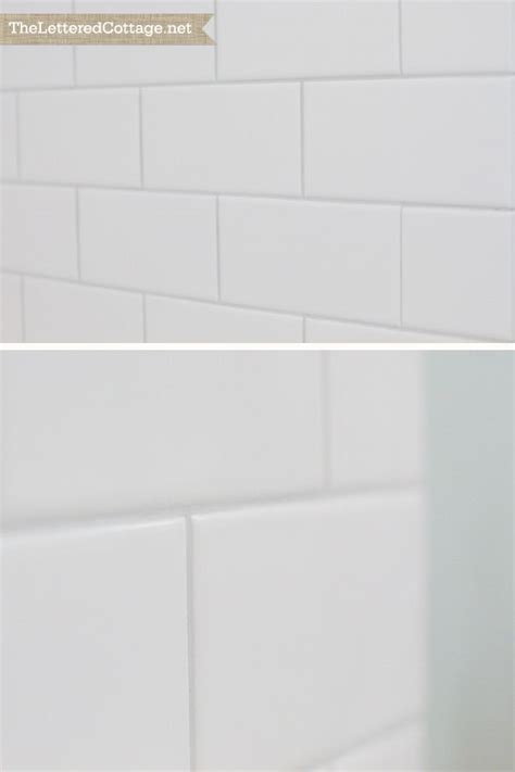 warm gray grout white subway tile bathroom organization house ideas white