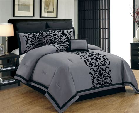black and grey comforter bedroom decor with black tufted upholstered
