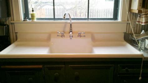 1910 Farm sink with built in backsplash and double