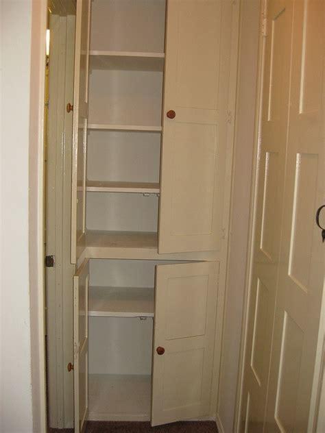 built in floor to ceiling linen closet hallway built