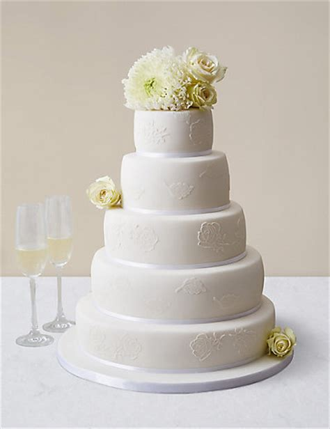 embroidered lace wedding cake white icing serves  ms