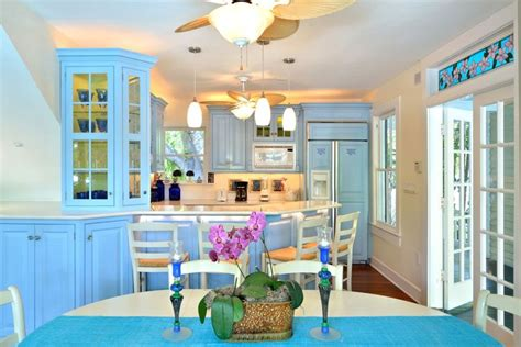 how to set kitchen cabinets periwinkle kitchen cabinets are profoundly tropical in our 7358