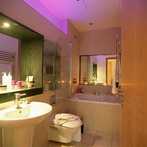 space saving ideas for small bathrooms small bathroom with white suite and mirrors housetohome