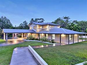 concrete modern house exterior with circular driveway With exterior house lighting australia