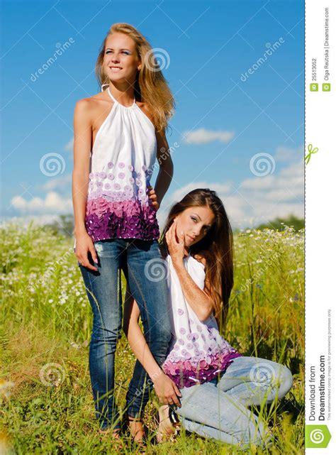 happy women  fun posing enjoying sun stock