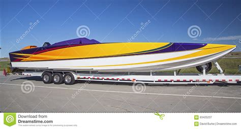 Boat Paint Terms by Racing Boat Striping Trailer Parked Color Stock Image