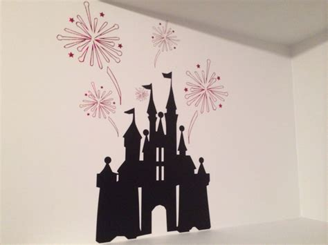 All about cricut svg file. Disney castle and fireworks above a shelf with vinyl and ...