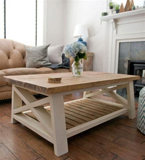 Assouline understands that an oversized coffee table book is there to inspire conversation. gorgeous light wood and cream paint farmhouse style coffee table with wood slats from Pine + M ...