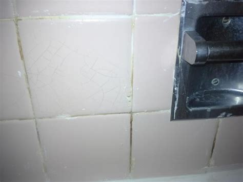 rust stains in tile grout cracks in bathroom tile