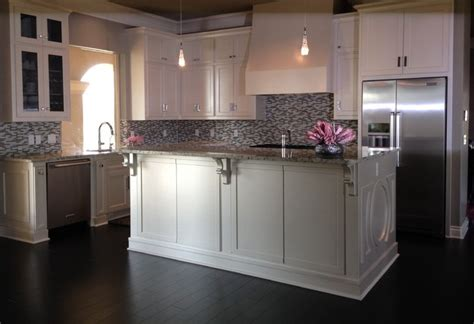 white kitchen with glass tile backsplash contemporary
