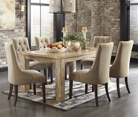 ashley furniture dining tables and chairs 7 piece dining set with upholstered side chairs by
