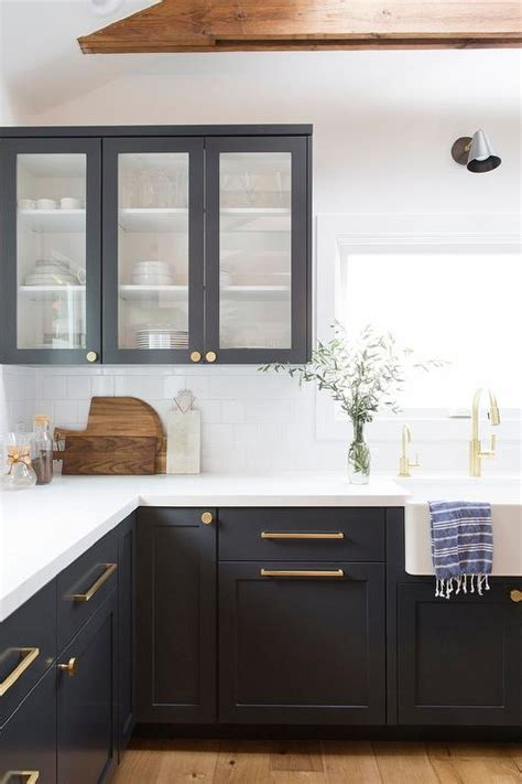 black shaker cabinets  brushed gold pulls  knobs