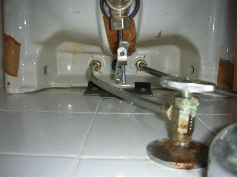 sink disposal leaking from bottom water leaking on bottom of faucet when turned on