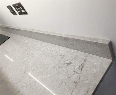 kitchen cabinets in gray hammersmith building in caesarstone 6131 bianco drift 6131