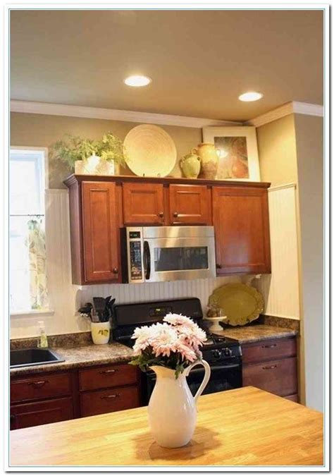 over the kitchen sink wall decor home decor above cabinet decorating ideas bronze kitchen