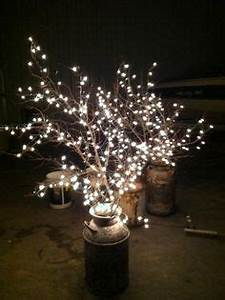 Cheap wedding lighting Use old milk cans branches and