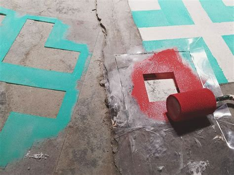 graffiti artist spray paints abandoned buildings floors