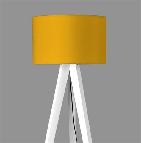 elephant glass table tripod l cylindrical mustard contemporary floor