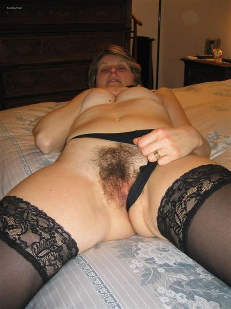 Mature lady friend revealing her moist hairy... Full-size image #1