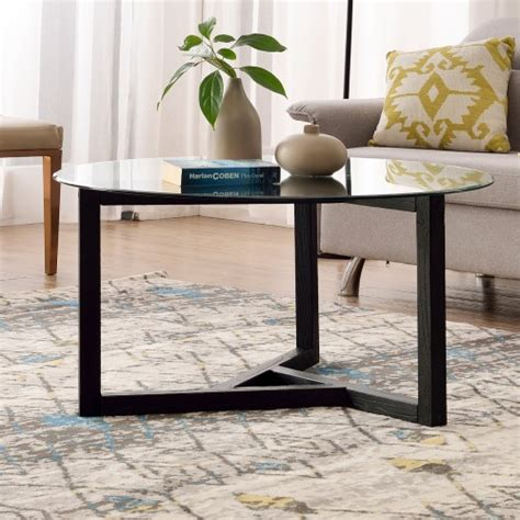 Is a masterpiece of modern design. TREXM Round Glass Coffee Table Modern Cocktail Table Easy Assembly Sofa Table for Living Room ...