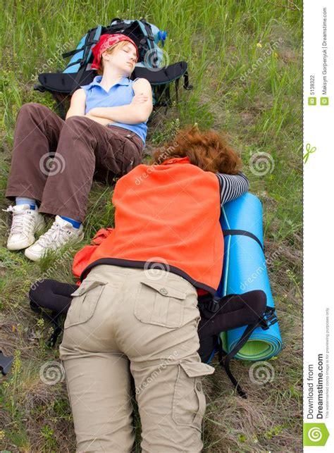 hiker girls sleeping  backpacks stock photography